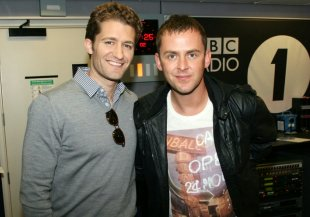 Mr Schuester off of Glee talks to moon face